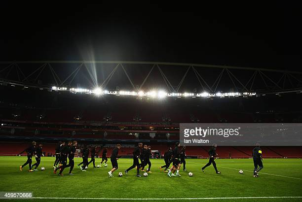 Players warm up during a Borussia Dortmund training session ahead of the UEFA Champions League Group D match against Arsenal at Emirates Stadium on...