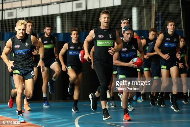 Players warm up during a Carlton Blues AFL media opportunity at Ikon Park on March 3 2017 in Melbourne Australia