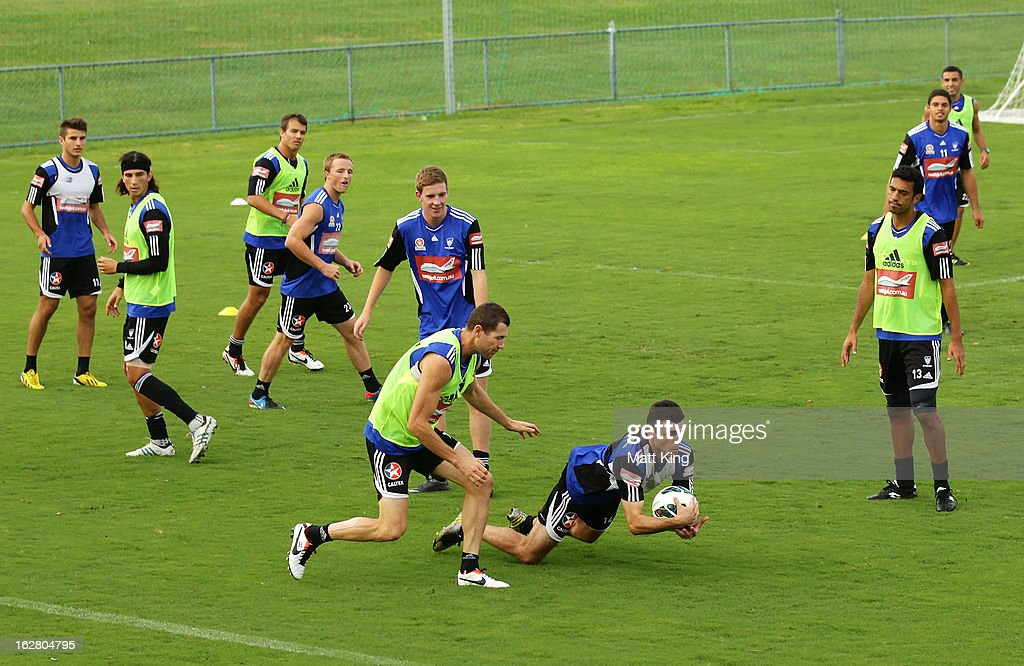 Players warm up during a Sydney FC A-League training session at Macquarie Uni on February 28, 2013 in Sydney, Australia.