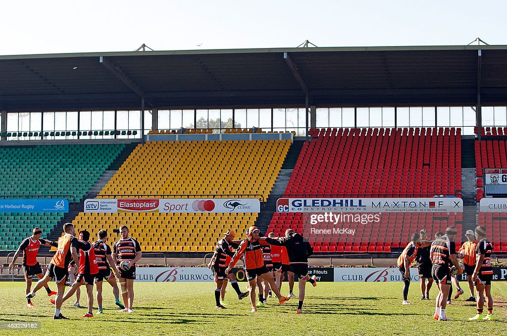 Players warm up during a Wests Tigers NRL training session at Concord Oval on August 6, 2014 in Sydney, Australia.