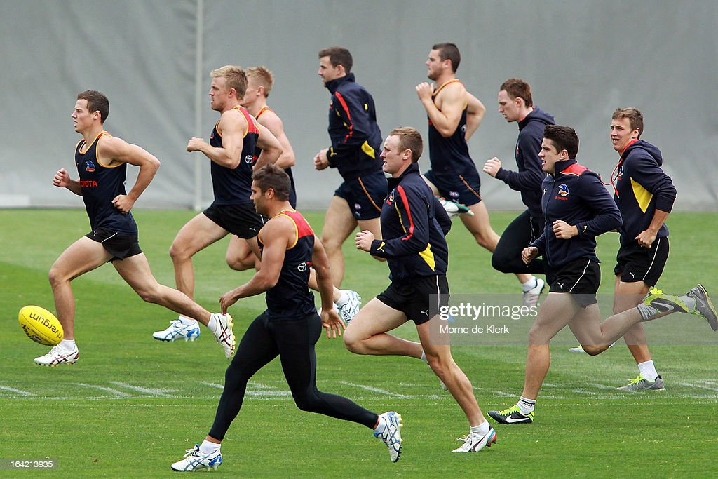 Players warm up during an Adelaide Crows AFL training session at AAMI Stadium on March 21, 2013 in Adelaide, Australia.
