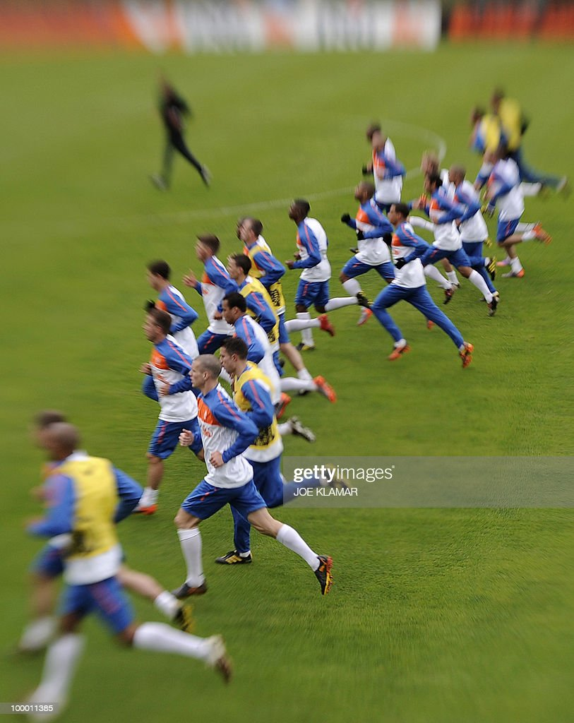 Players warm up during the first Netherland's team's practice on the opening of their training camp in the Tyrolian village of Seefeld in Austria on 20 May 2010 in preparation for the 2010 FIFA World cup hosted by South Africa from June 11 to July 11.