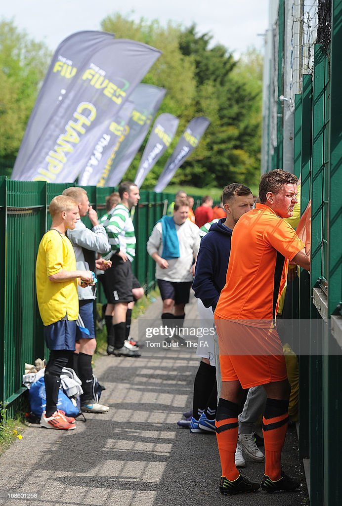 Players watch a match during the FA Fives at Power League Community on May 12, 2013 in Basingstoke, England.