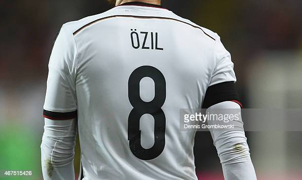 Players wear a black ribbon in remembrance of the victims of Germanwings flight 4U9525 during the International Friendly match between Germany and...