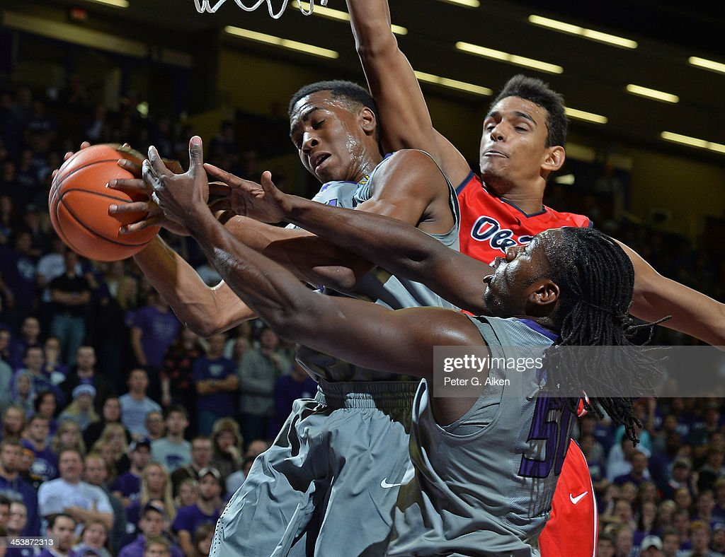 Players Wesley Iwundu #25 and D.J. Johnson #50 of the Kansas State Wildcats go for a rebound against forward Anthony Perez #13 of the Mississippi Rebels during the first half on December 5, 2013 at Bramlage Coliseum in Manhattan, Kansas. Kansas State won 61-58.