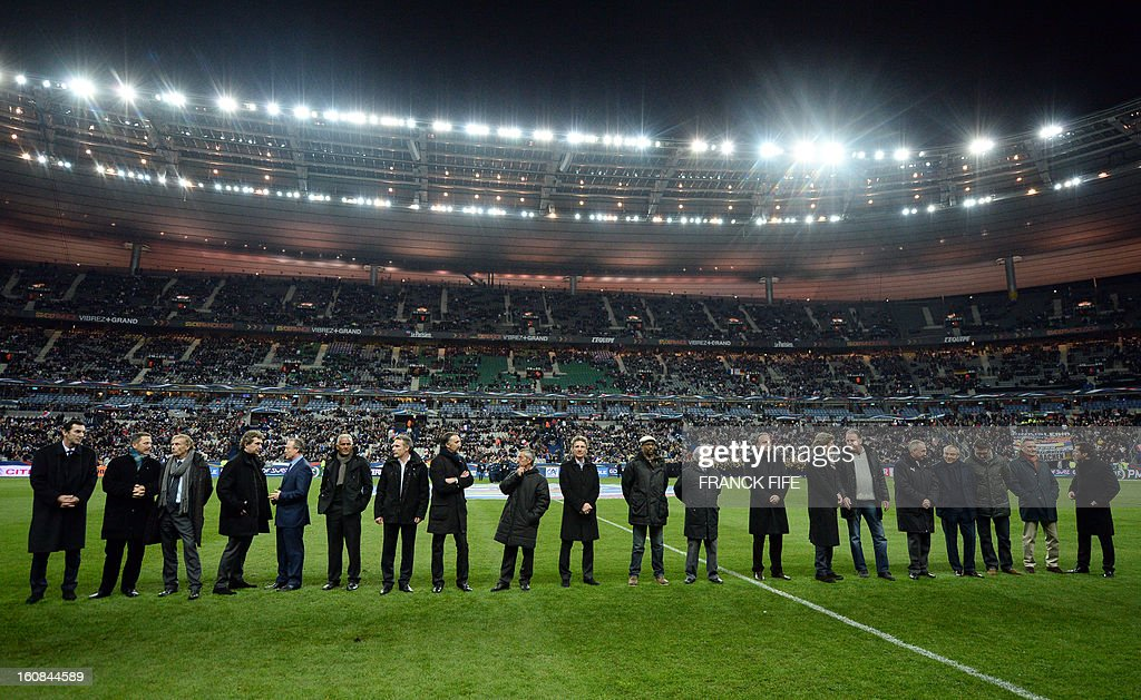 Players who played the World Cup 1982 semi final match between France and Germany stand on the pitch before a friendly international football match between France and Germany on February 6, 2013 at the Stade de France in Saint-Denis, near Paris. The match marks the 50th anniversary of the establishment of the Elysee Treaty, which paved the way for friendly relations between two countries that had previously endured a long and bitter rivalry.