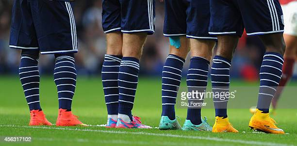 WBA players with a range of multicoloured boots line up at a wall during the Barclays Premier League match between West Bromwich Albion and Burnley...