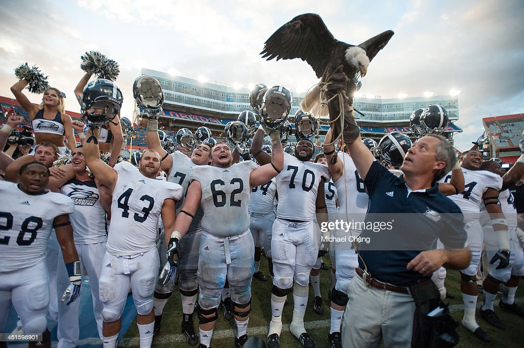 Players with the Georgia Southern Eagles celebrate after defeating the Florida Gators 2620 on November 23 2013 at Ben Hill Griffin Stadium in...