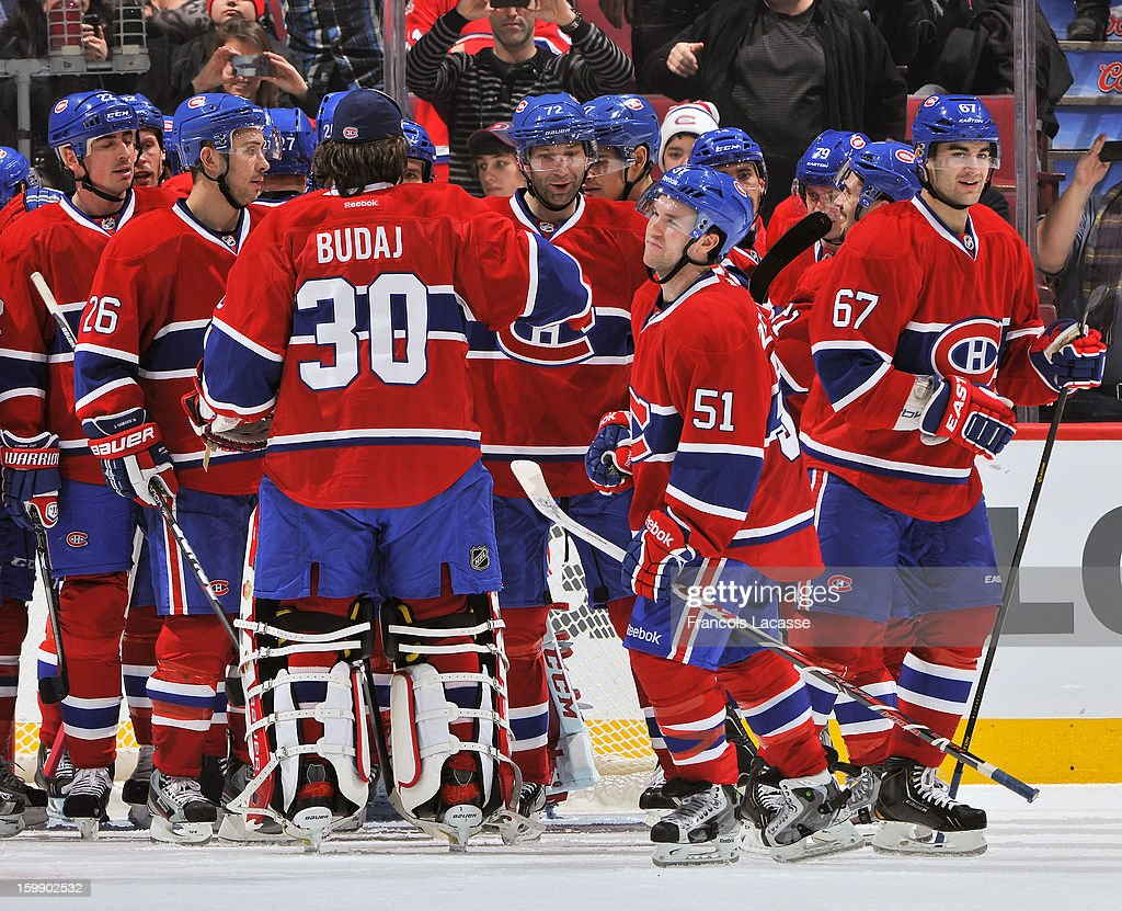 Players with the Montreal Canadiens celebrate their first victory of the season after the NHL game against the Florida Panthers on January 22, 2013 at the Bell Centre in Montreal, Quebec, Canada.