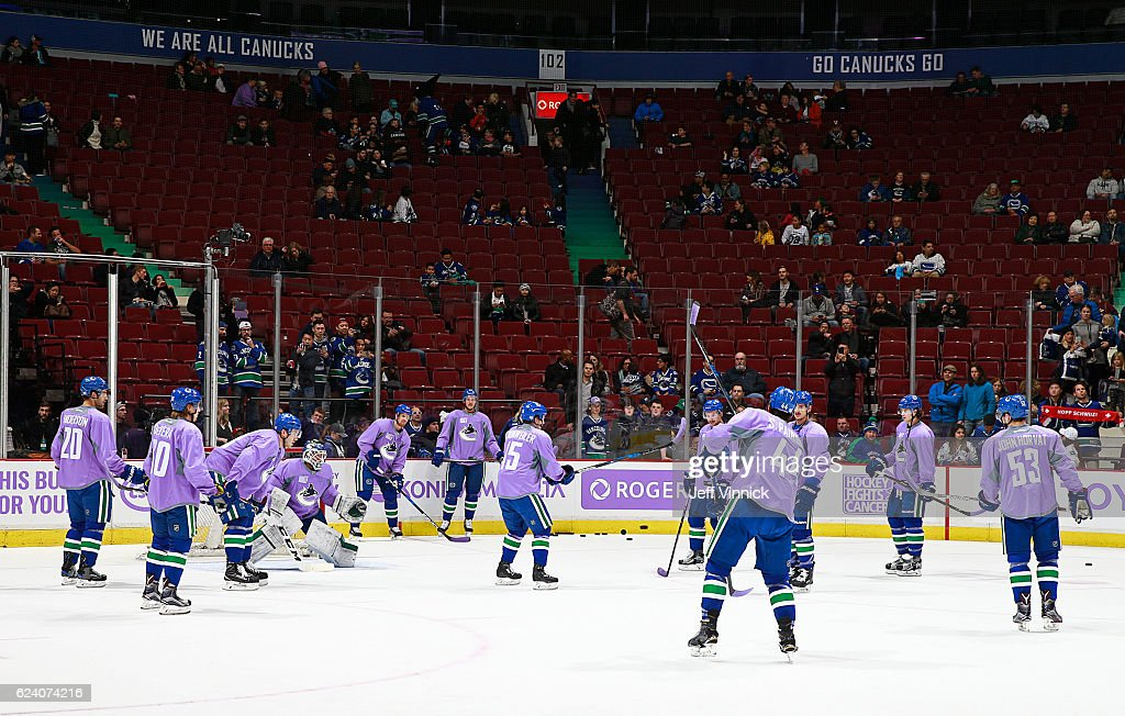 Players with the Vancouver Canucks wear jerseys honouring a personal cancer victim on Hockey Fights Cancer night before their NHL game against the Arizona Coyotes at Rogers Arena November 17, 2016 in Vancouver, British Columbia, Canada.