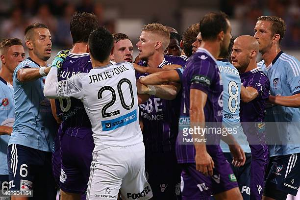 Players wrestle after an altercation between Dino Djulbic of the Glory and Jacques Faty of Sydney during the round 16 ALeague match between the Perth...
