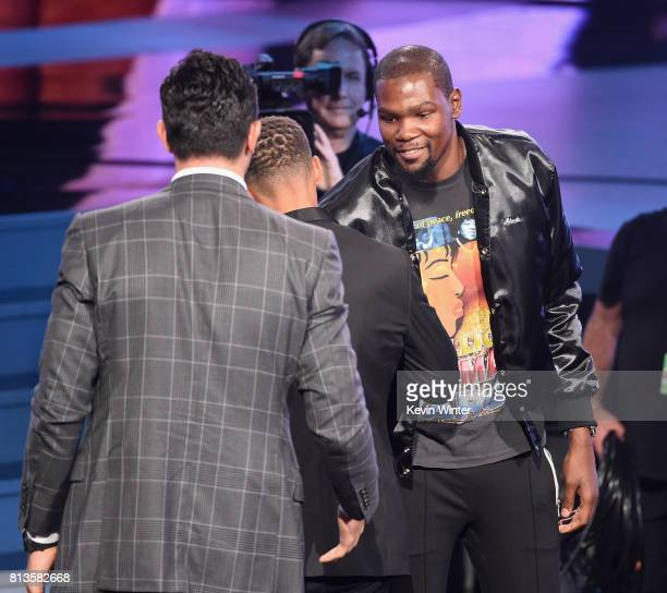 NBA players Zaza Pachulia Steph Curry and Kevin Durant accept the Best Team award on behalf of the NBA champion Golden State Warriors onstage at The...
