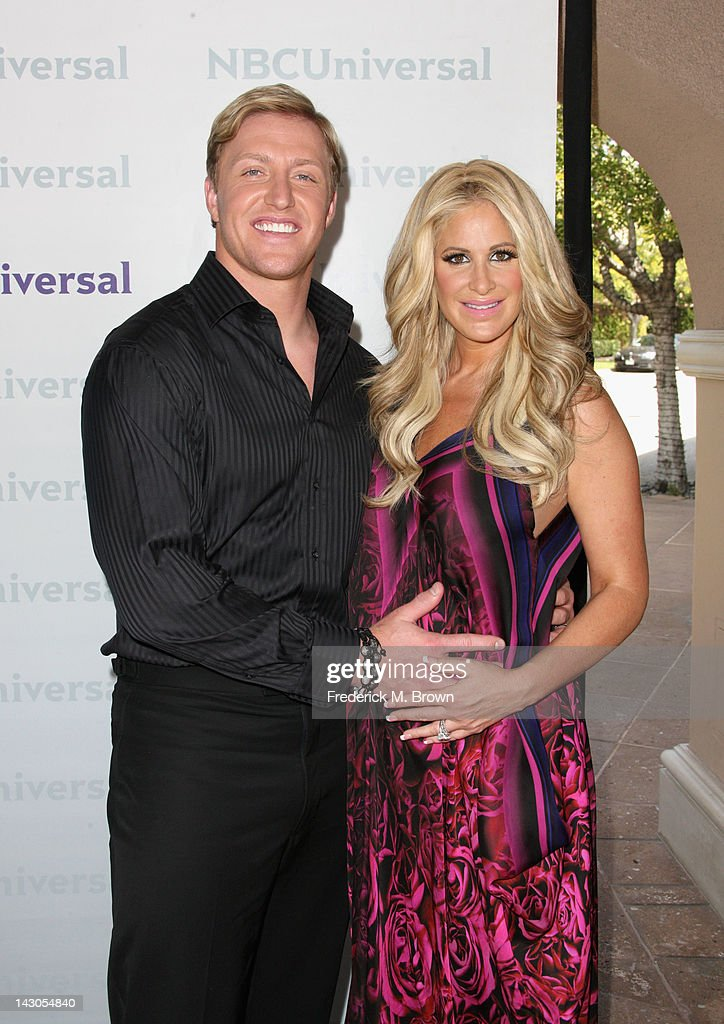 Player/TV Personality <a gi-track='captionPersonalityLinkClicked' href=/galleries/search?phrase=Kroy+Biermann&family=editorial&specificpeople=5085129 ng-click='$event.stopPropagation()'>Kroy Biermann</a> and TV Personality <a gi-track='captionPersonalityLinkClicked' href=/galleries/search?phrase=Kim+Zolciak&family=editorial&specificpeople=5446357 ng-click='$event.stopPropagation()'>Kim Zolciak</a> arrive at the NBCUniversal summer press day held at The Langham Huntington Hotel and Spa on April 18, 2012 in Pasadena, California.