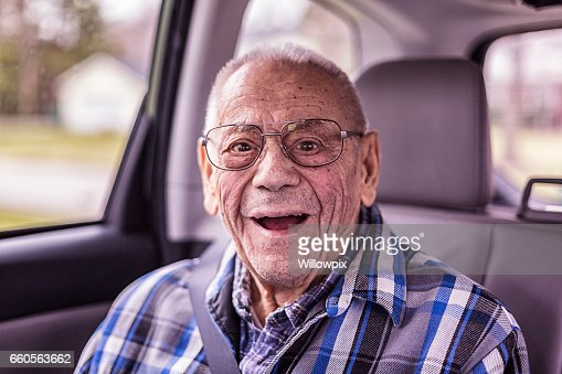 Playful 94 Year Old Grandpa Portrait in the Car : Stock Photo