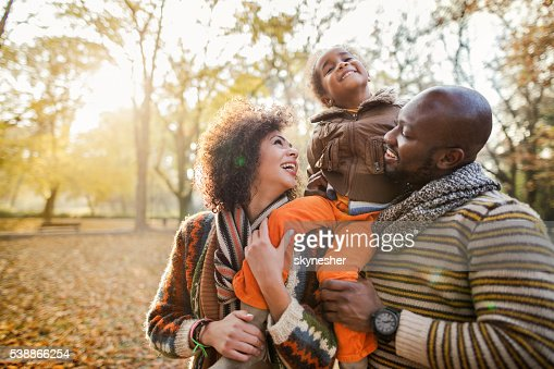 Playful African American couple enjoying a day in nature.