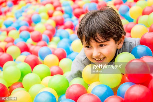 Playful boy at the ball pool