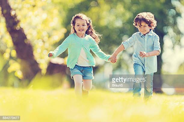 Playful children running outdoors.
