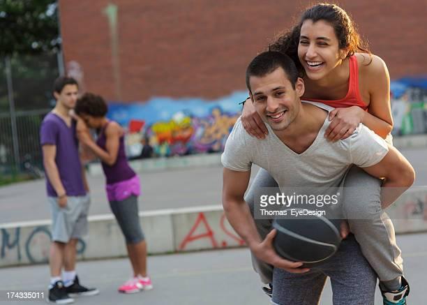 Playful Couple on Basketball Court