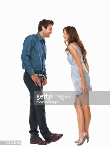 Playful couple smiling and looking at each other : Stock Photo