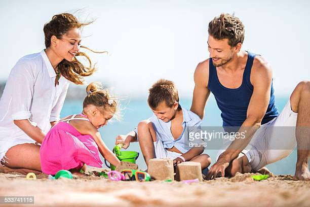 Playful family at the beach.