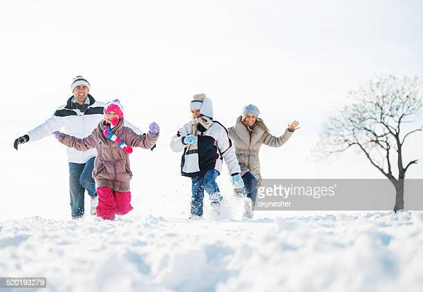 Playful family during winter season.