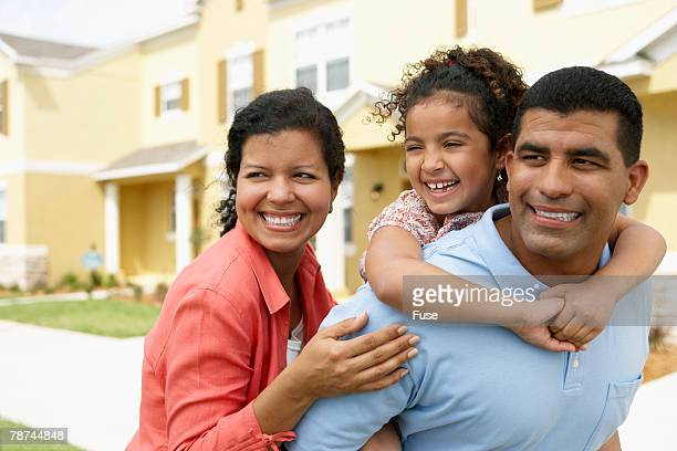 Playful Family in Front of Their House