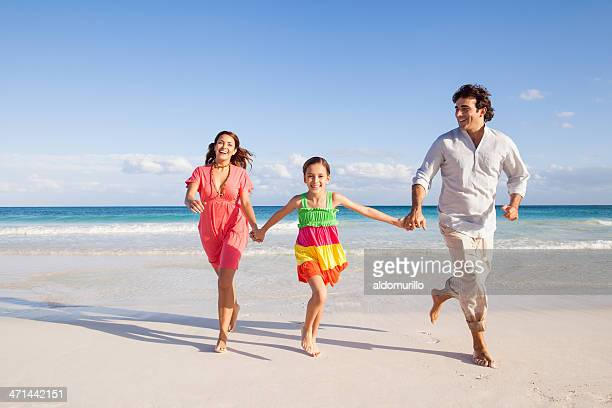 Playful family in the beach