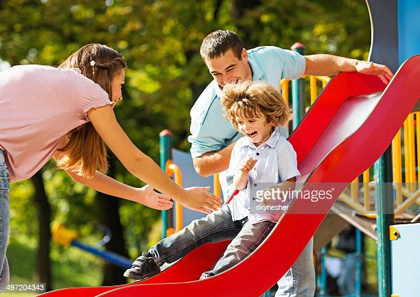 Playful family in the playground.