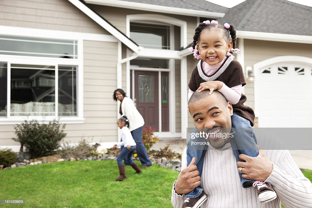 Playful Family of Four at Home : Stock Photo