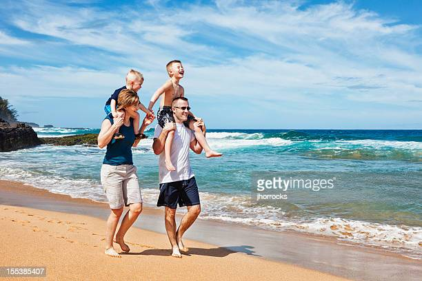 Playful Family of Four at The Beach