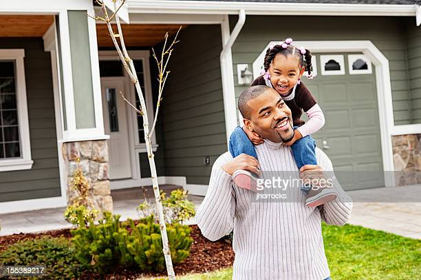 Playful Father and Daughter at Home