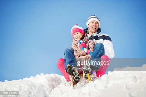 Playful father and daughter in winter. : Stock Photo