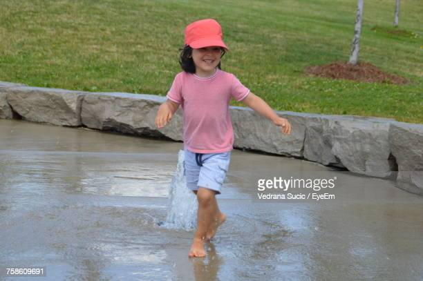 Playful Girl Walking At Fountain