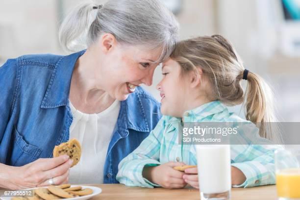 Playful grandmother enjoys time with her granddaughter