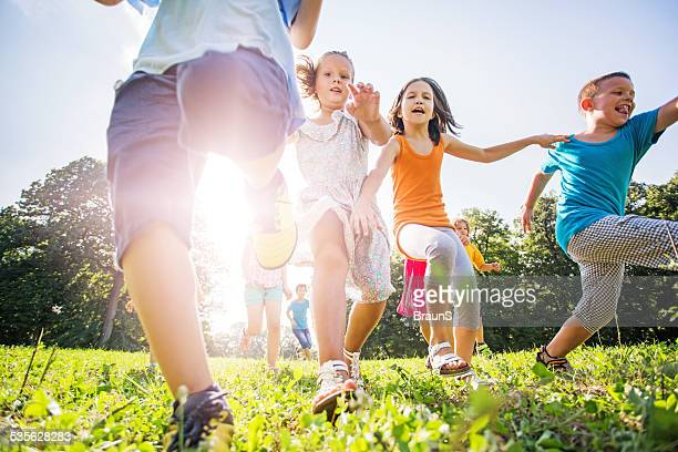 Playful group of children running outdoors.