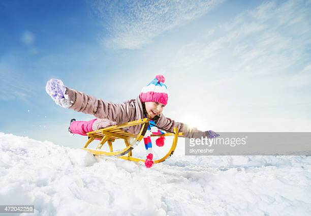 Playful little girl during winter day.