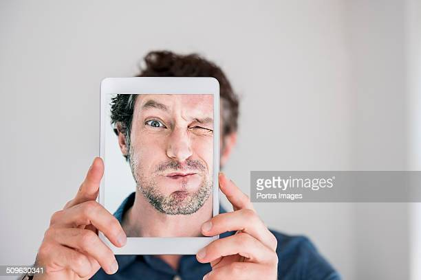 Playful man taking self portrait
