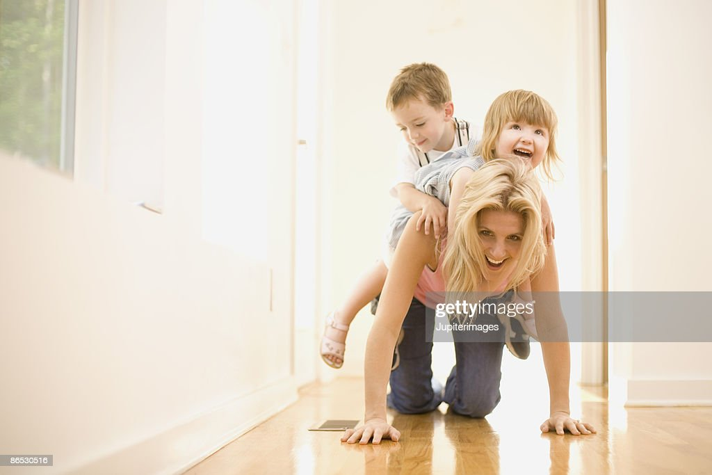 Playful mother and children : Stock Photo