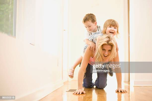 Playful mother and children