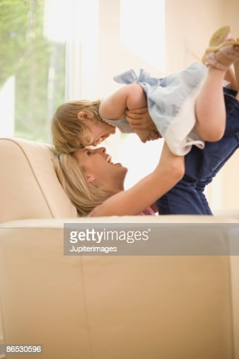 Playful mother and daughter : Stock Photo
