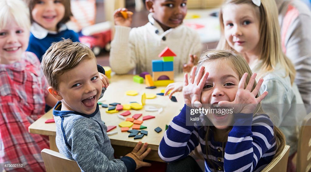 Playful preschoolers having fun making faces : Stock Photo