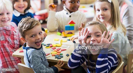 Playful preschoolers having fun making faces