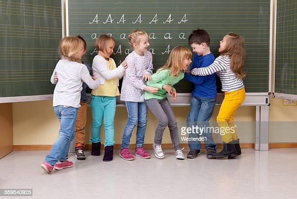 Playful pupils in classroom