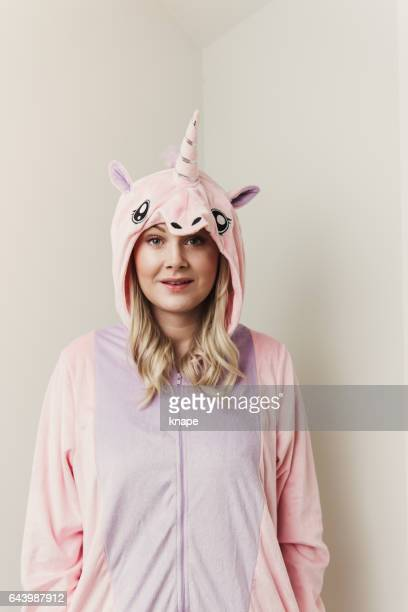 Playful woman in unicorn costume.