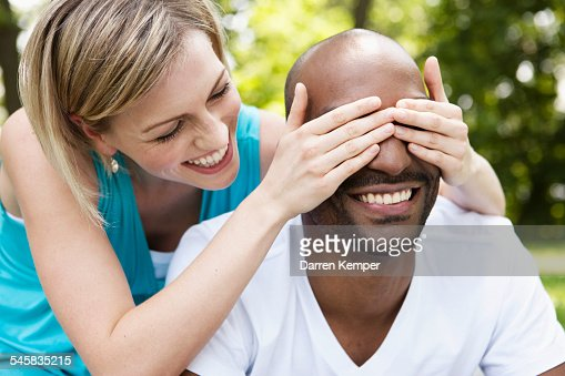 Playful young couple in a park : Stock Photo