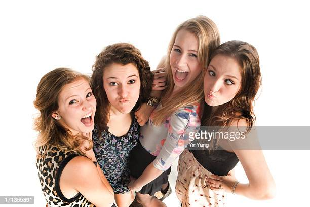 Playful Young Girls Making Faces at Camera on White Background