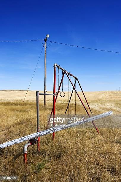 Playground and swing set in rural field