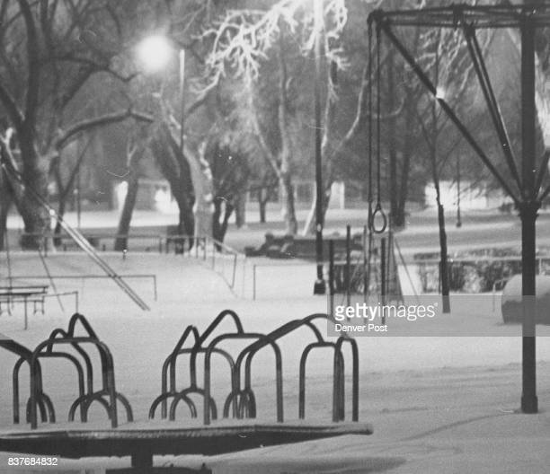 Playground at Washington Park is covered by snow in photo taken Wednesday night Up to two feet of new snow was reported in some mountain areas Denver...