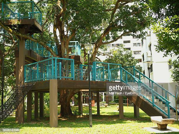 Playground Equipment In Park Against Tree