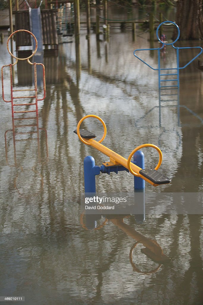 A playground is submerged by flood waters in the village of Wraysbury on the banks of the river Thames on February 13, 2014 in Wraysbury, England. The Environment Agency continues to issue severe flood warnings for a number of areas on the River Thames in the commuter belt west of London. With heavier rains forecast, people are preparing for the water levels to rise.